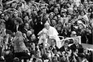 Pope Francis kissing baby in crowd